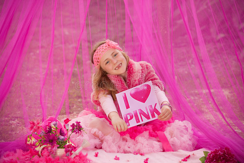 Pink child. Pretty in pink, little girl all dressed in pink