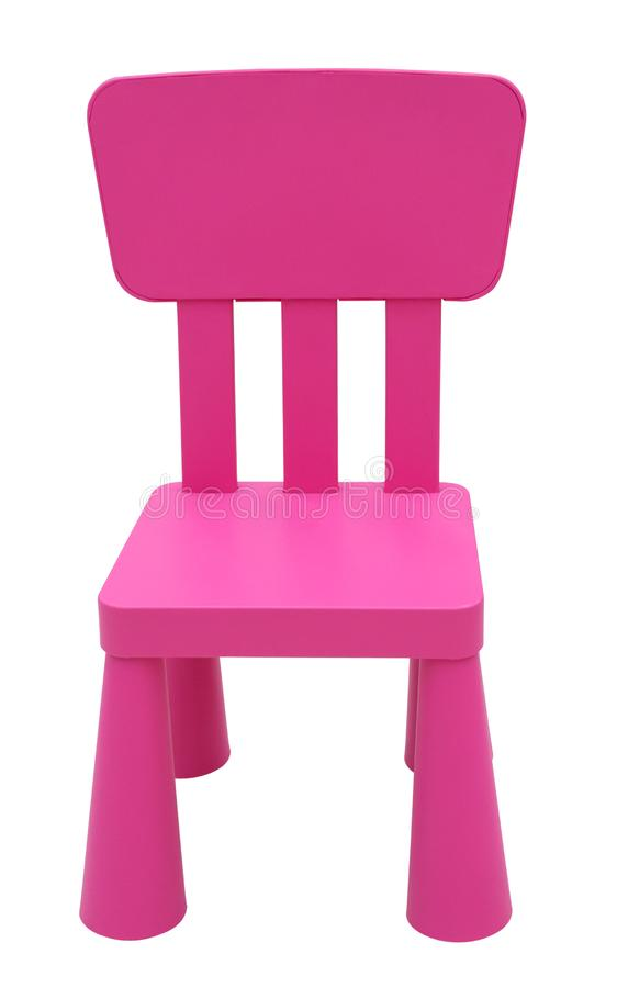 Pink children`s plastic chair isolated on white royalty free stock photo