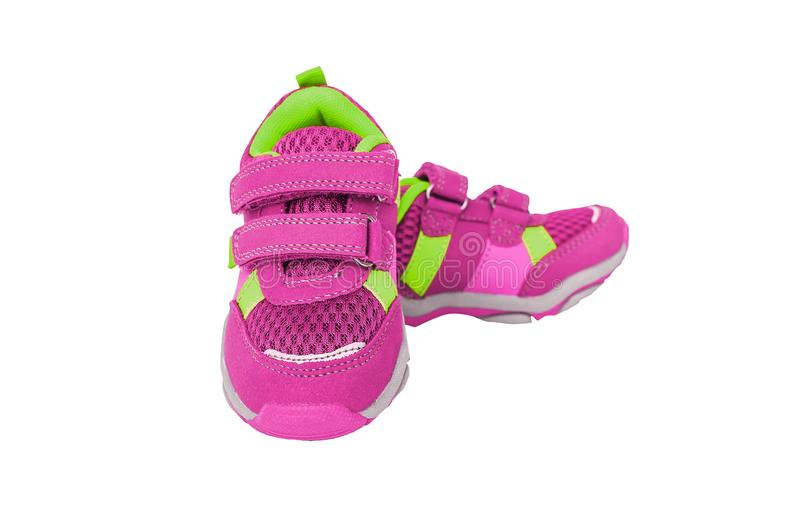 Pink children`s sneakers. Stylish pink children`s sneakers. Isolated on white background stock photo