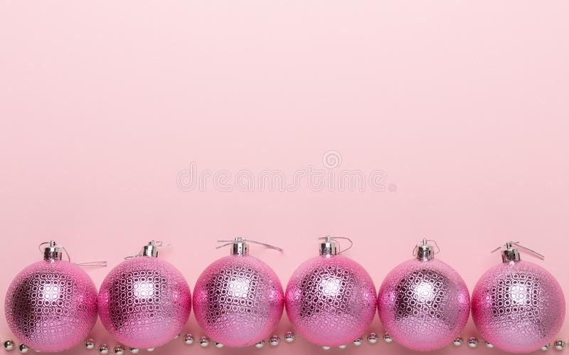 Pink christmas balls on a paper background stock photo