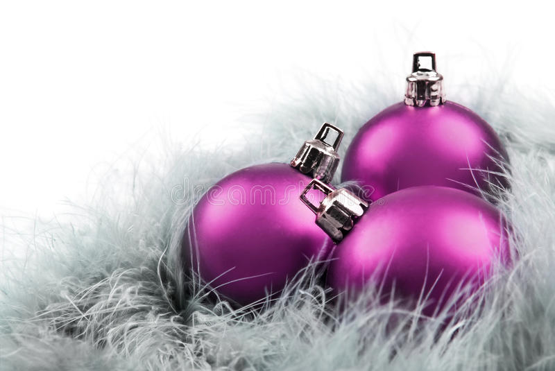 Pink christmas baubles stock photography