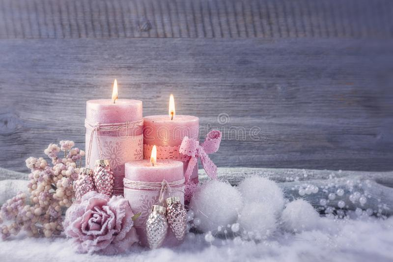 Four pink christmas candle. Pink christmas candle for christmas royalty free stock photography