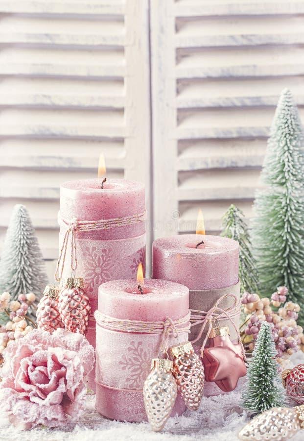 Pink christmas candle stock photography