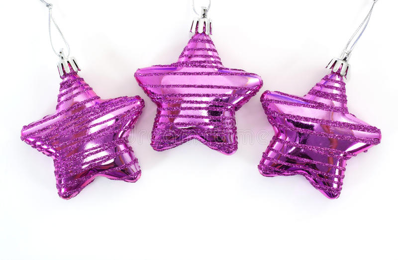Pink christmas star. On white background royalty free stock images