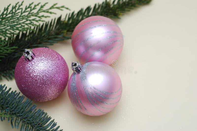 Pink Christmas Tree Glass Balls and and Fir Branches on Ivory Background with Copy Space royalty free stock image