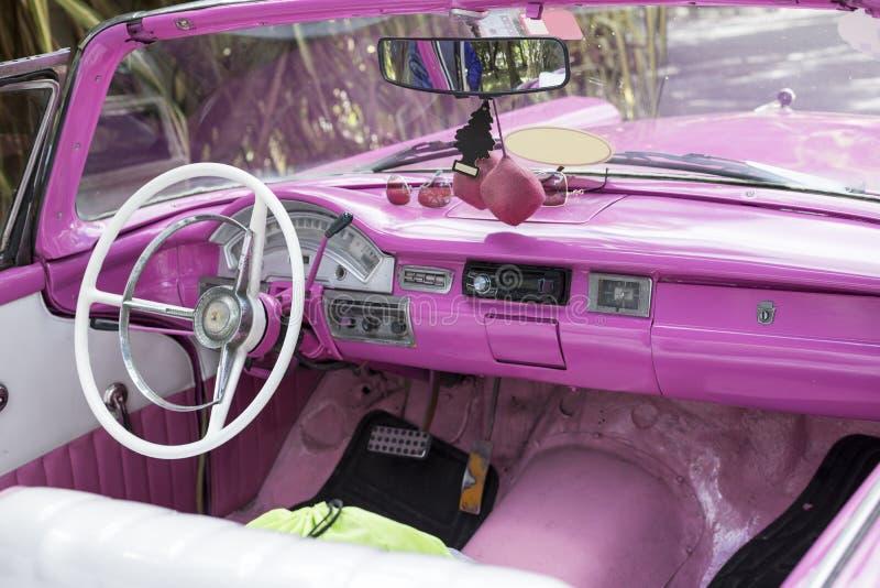 Pink classic car, Cuba royalty free stock photography