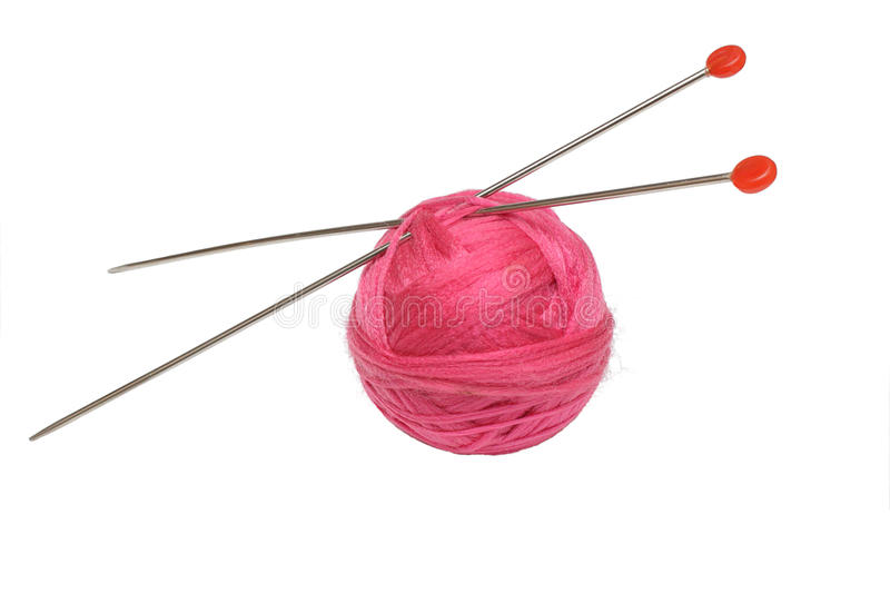 Pink clew and knitting needles isolated on white