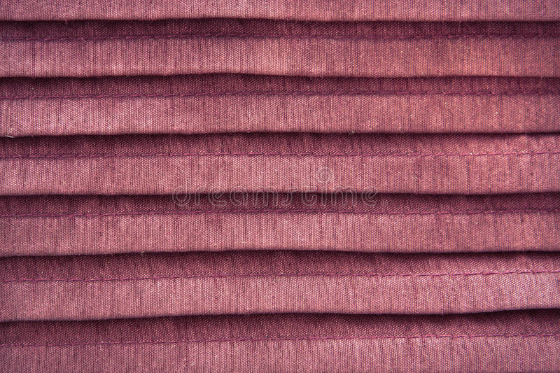 Pink cloth. Close up of pleated pink cloth as a background royalty free stock photos