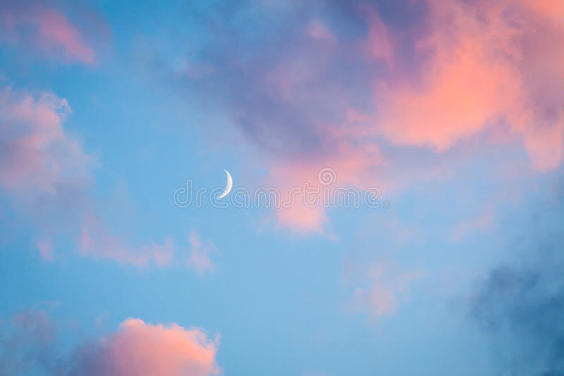 Pink clouds and moon heaven stock photography