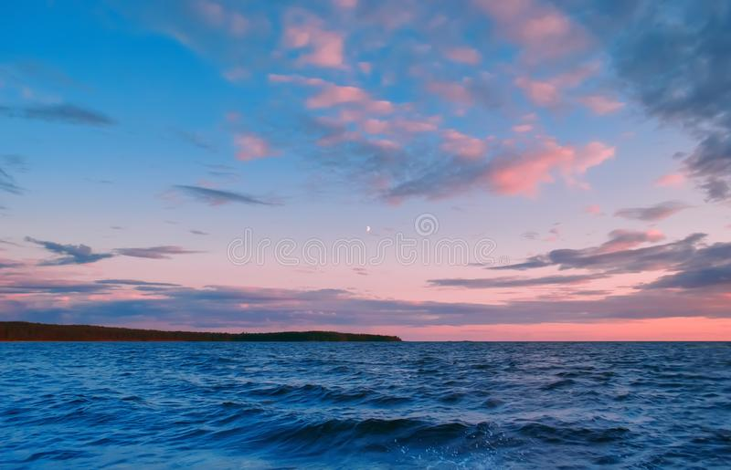 Pink Clouds Over The Lake stock photography