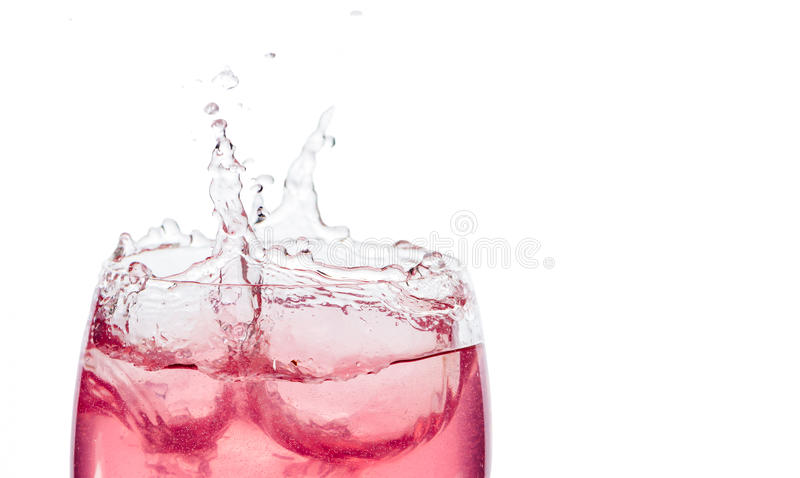 Pink cocktail splash. On white background royalty free stock photography