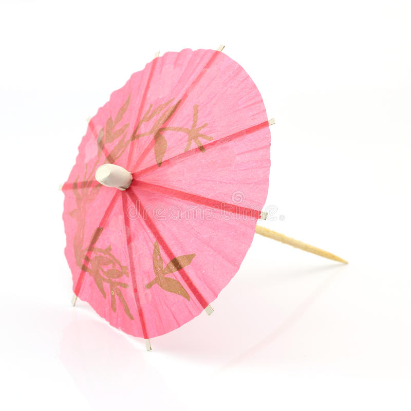 Pink cocktail umbrella. Isolated on white background stock photography