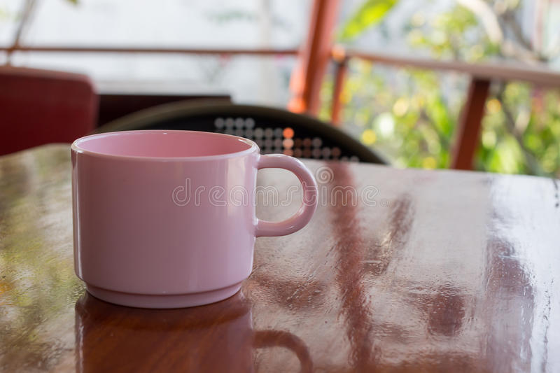 Pink coffee cup Placed on a wooden table glitter royalty free stock image