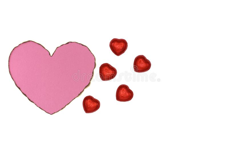 Pink color heart love shape with burnt white paper. stock photography