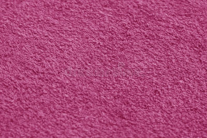 Pink color towel surface close-up with blur effect. stock image