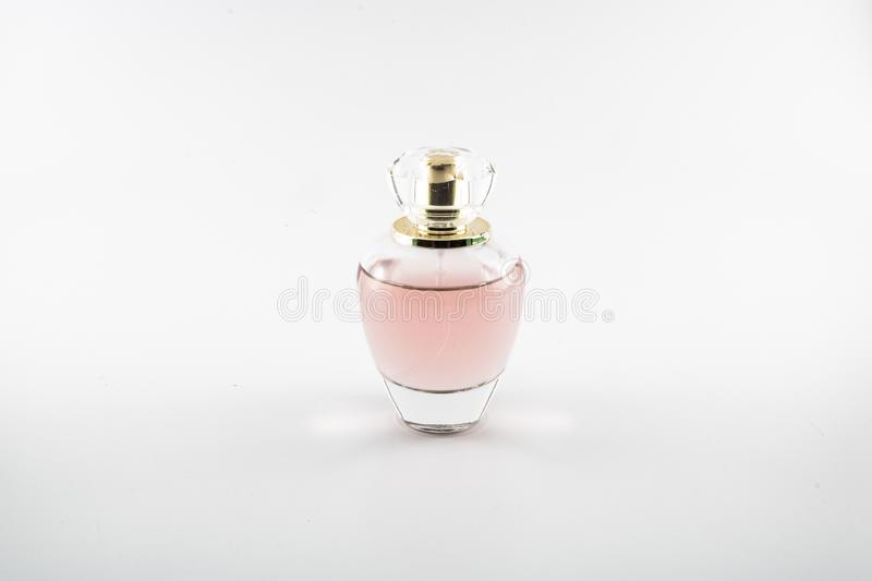Pink colored parfum. It was taken in the studio royalty free stock images