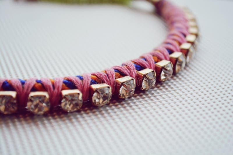 Pink colorful bracelet stock photos