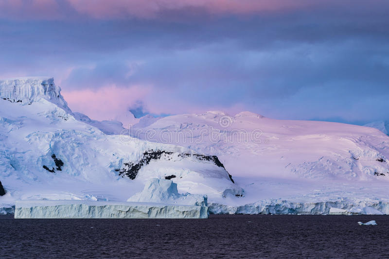 Pink colours at Sunset in Gerlache Strait. At Antarctica royalty free stock photography