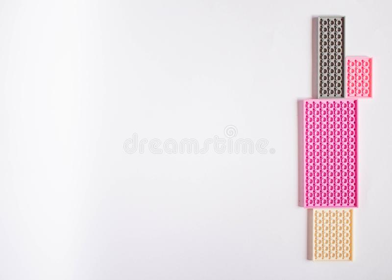 Pink constructor on a white background. Texture. Minimalism concept, Flat lay, top view, background royalty free stock images