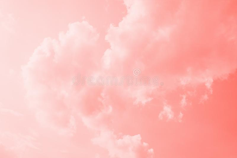 Pink coral color sky background with white clouds. Coral gradient background royalty free stock images
