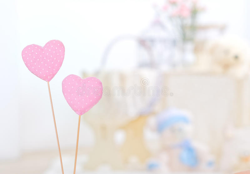 Pink cotton hearts. Close-up of pink textile hearts on blurry background stock photography