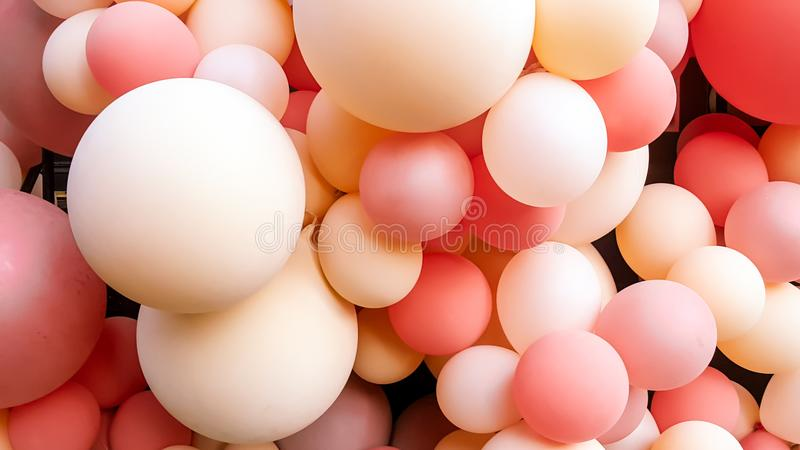 A bulk of pink and cream balloon. Pink and cream shaded balloons closely positioned to one another. they are in different sizes stock photos