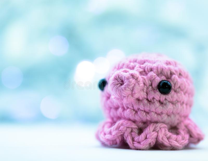 Pink Crochet Squid or Octopus royalty free stock image