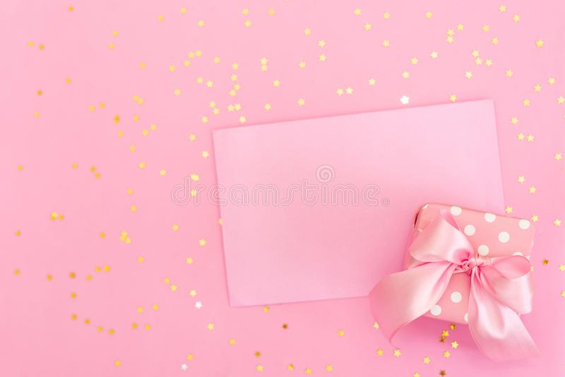 Pink crocheted hearts in envelope on pink background. Romantic congratulation on Valentine`s Day. Handmade, Love confession. Flat stock photos