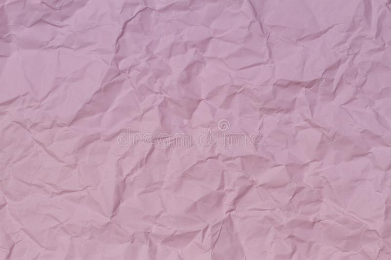 Pink crumpled wrinkled paper texture background stock photo