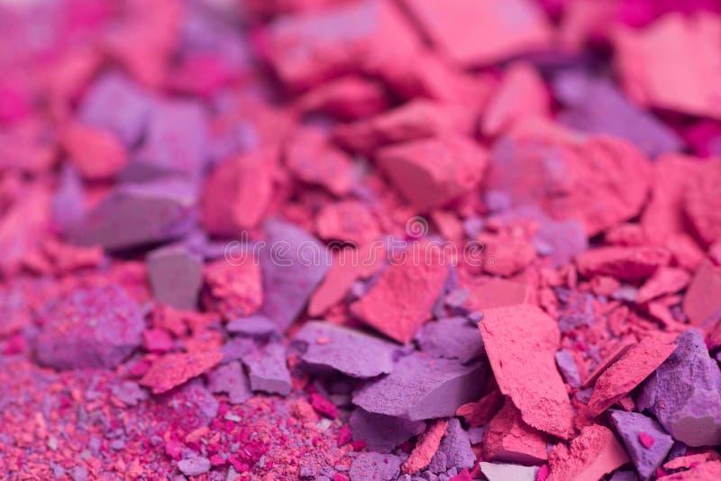 Pink crushed pastel crayon macro. Selective focus royalty free stock photography