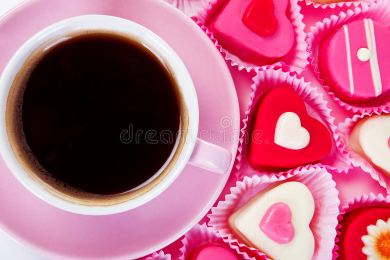 Pink cup with sweets royalty free stock photography