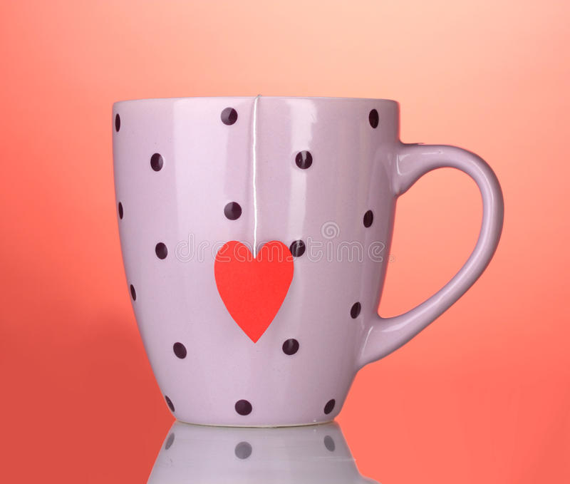 Download Pink Cup And Tea Bag With Red Heart-shaped Royalty Free Stock Photo - Image: 23679935