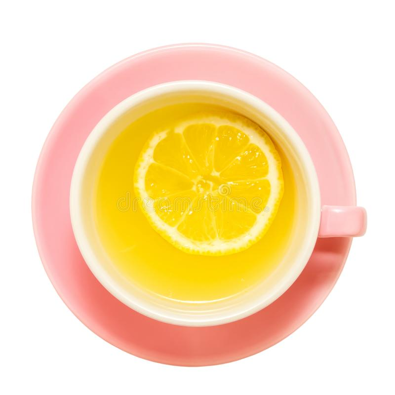 Pink cup of tea with a single piece of lemon royalty free stock image