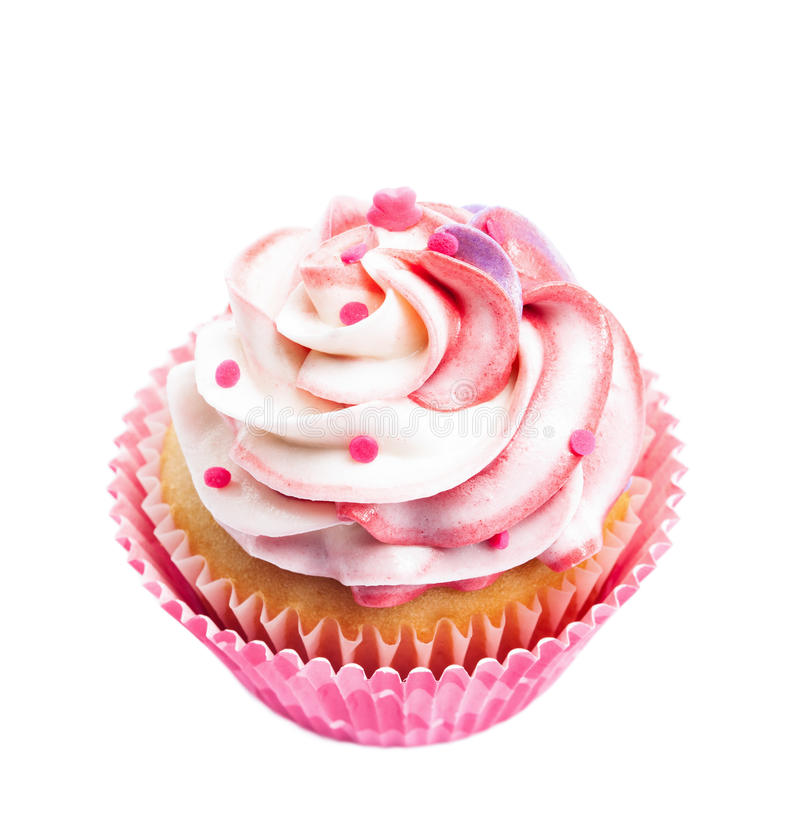 Pink Cupcake. A cup cake with pink and white buttercream icing isolated on white stock photos