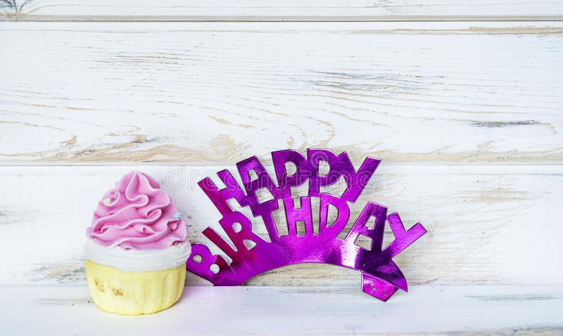 Pink Cupcake and Happy Birthday Text stock images