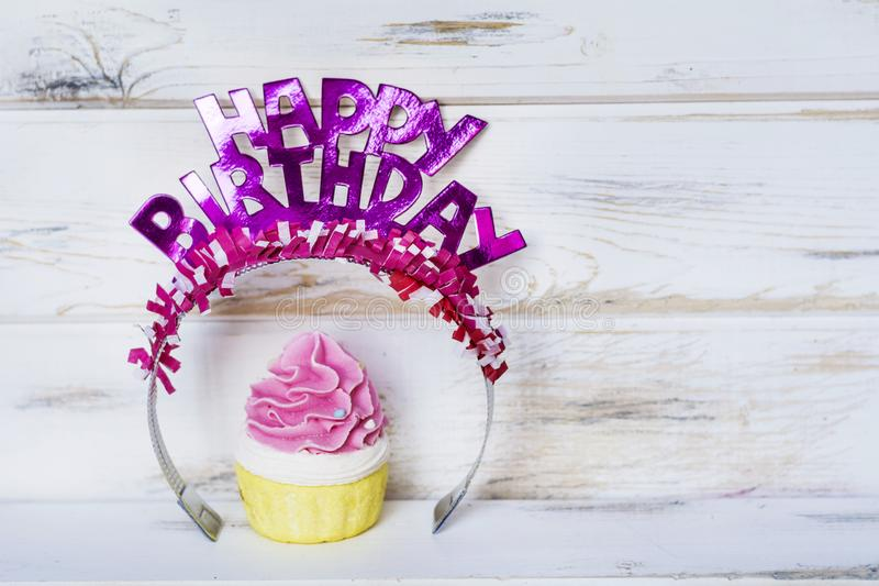Pink Cupcake and Happy Birthday Text royalty free stock photography