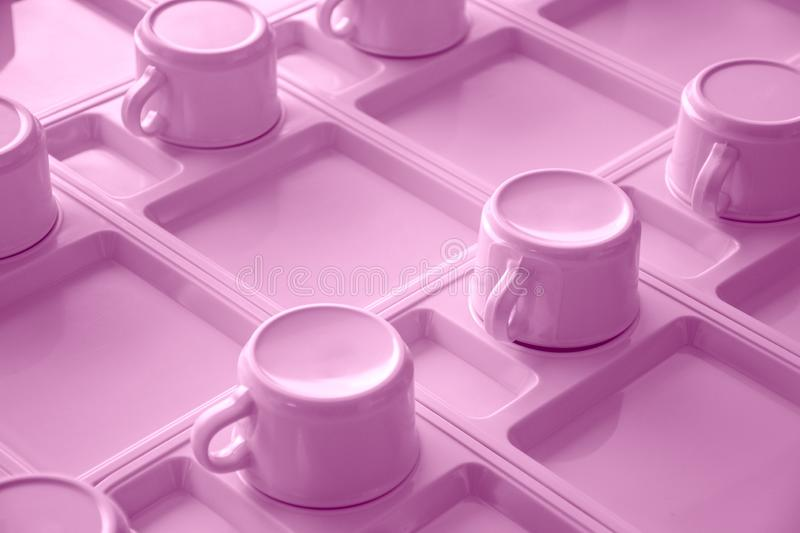 Pink cups in a row. Object and utensil concept. Coffee time theme stock photo
