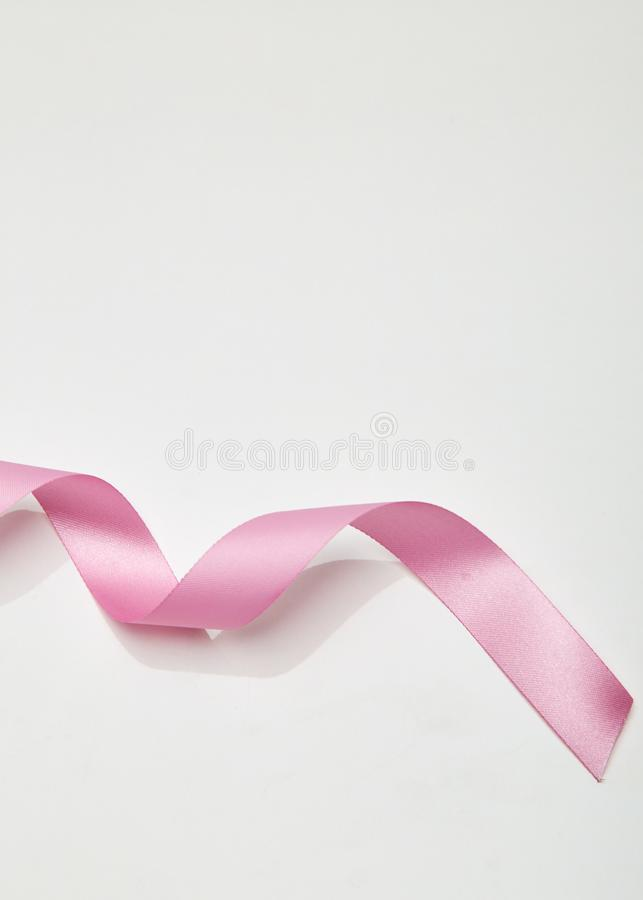 Pink curly ribbon on white stock photography