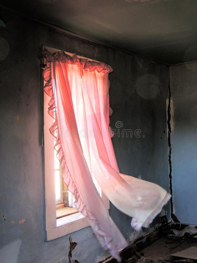 Pink curtains, blowing in. Abandoned house, new mexico stock photo