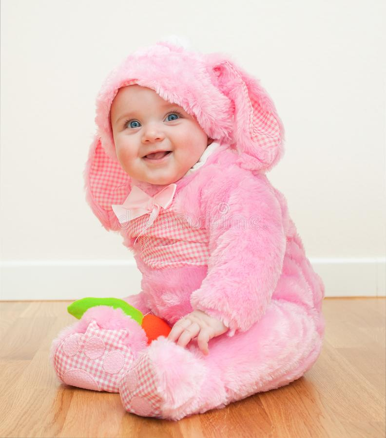 Pink cute baby in costume easter bunny stock photo