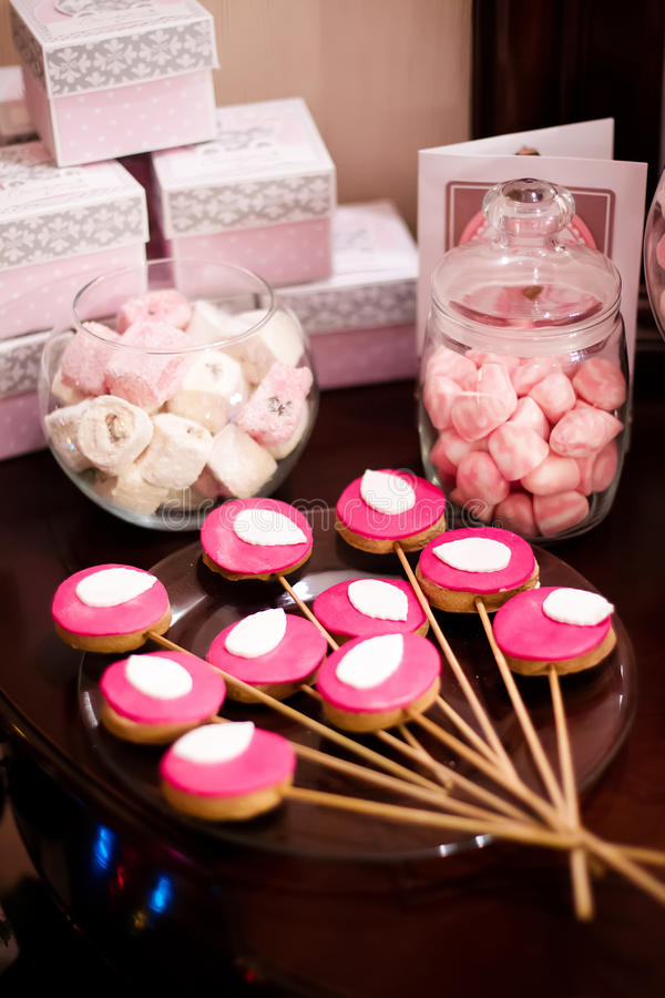 Pink design for kids birthday. Candy, sweets in glass vases stock photography