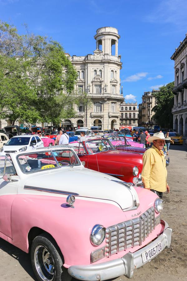 Pink dodge and a man in a hat, Cuba, Havana stock image