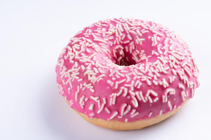 Pink donut on white background, close up macro royalty free stock image