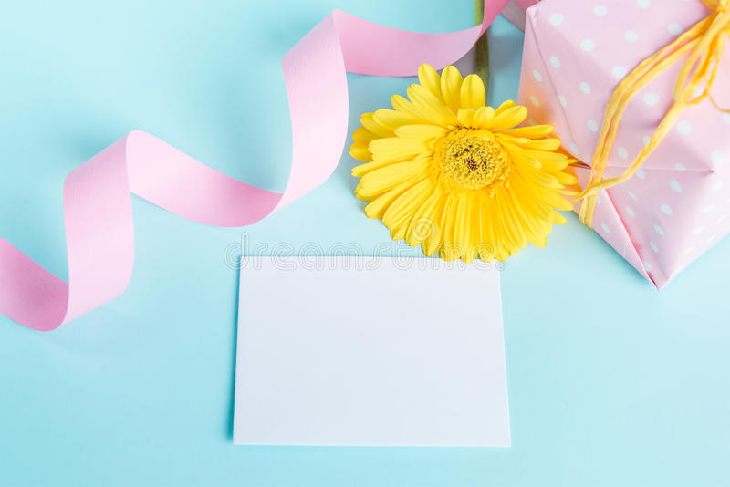 Pink Dotted Gift Box Yellow Gerbera Flower And Empty Card Over A