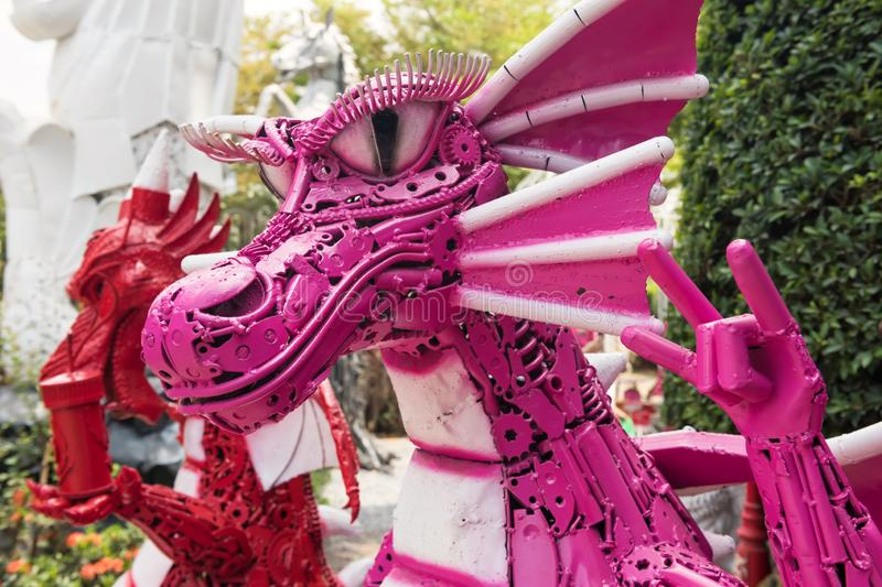 pink dragon made by iron old gear royalty free stock photo