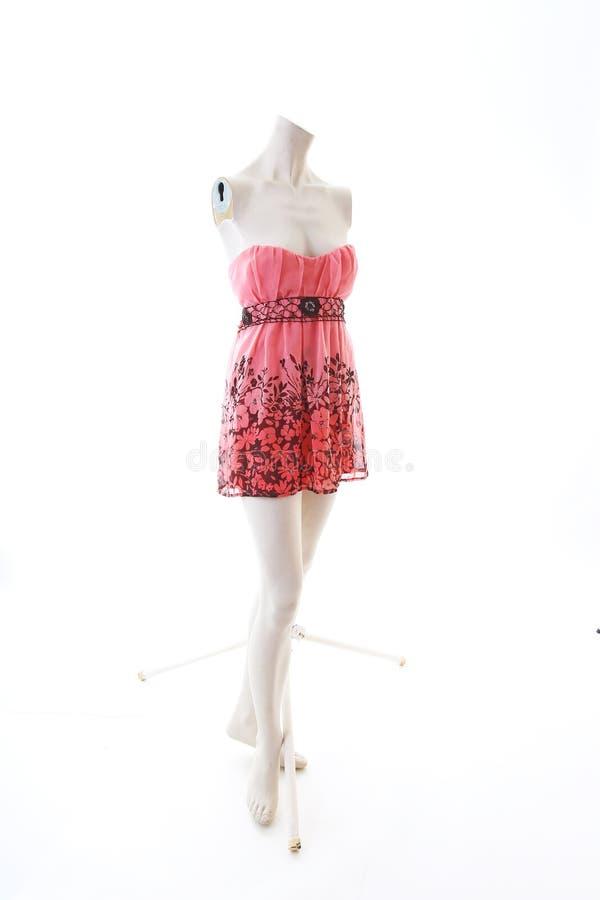 Pink dress long top mini dress on mannequin full body shop display. Woman fashion styles, clothes on white studio background... Pink dress long top mini dress royalty free stock photo