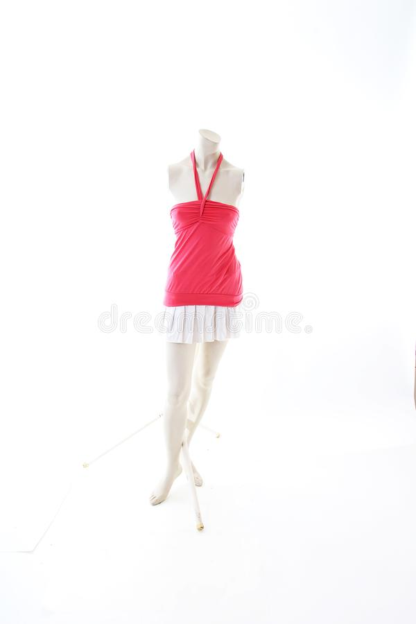 Pink dress long top mini dress on mannequin full body shop display. Woman fashion styles, clothes on white studio background. royalty free stock image