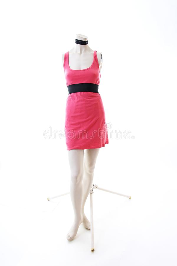 Pink dress long top mini dress on mannequin full body shop display. Woman fashion styles, clothes on white studio background. stock photo