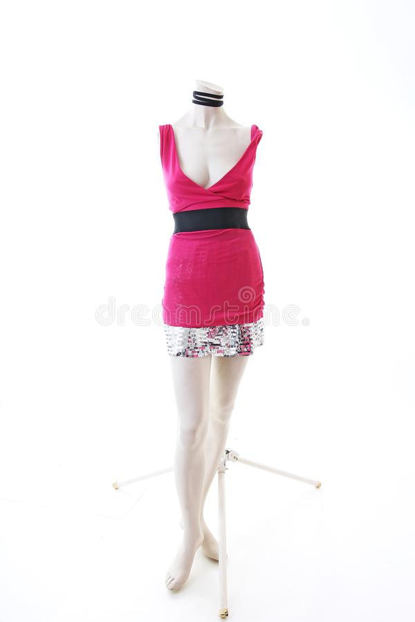 Pink dress long top mini dress on mannequin full body shop display. Woman fashion styles, clothes on white studio background. stock images