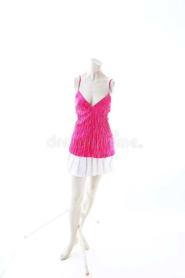 Pink dress long top mini dress on mannequin full body shop display. Woman fashion styles, clothes on white studio background. royalty free stock photo